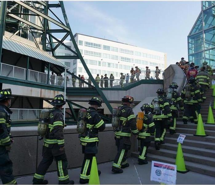 firefighters climbing stairs at event