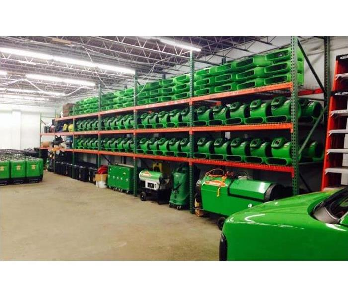 SERVPRO restoration equipment stacked inside storage facility